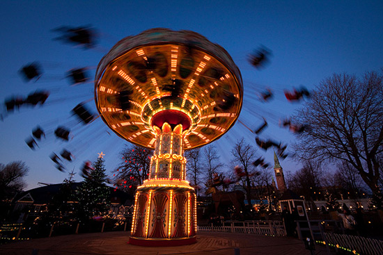 swing carousel in the evening. Subjects appear blurried